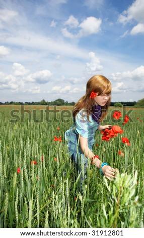 Beautiful smiling teenage girl  in poppy field - stock photo