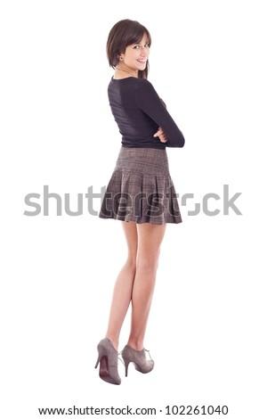 Beautiful smiling teenage girl posing in short skirt - stock photo