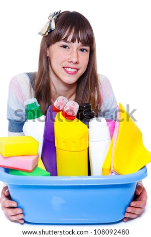 Beautiful smiling teenage girl with cleaning agents - stock photo