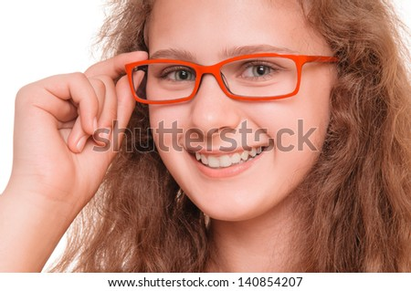 Beautiful smiling teenage girl with reading glasses. isolated on white background