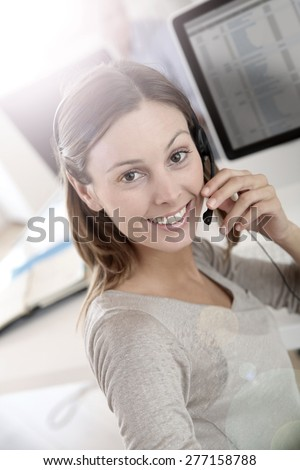 Beautiful smiling teleoperator with headset on