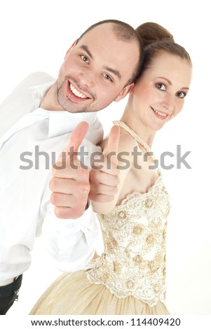 Beautiful smiling wedding couple thumbs up over white background - stock photo