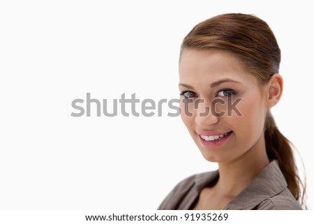 Beautiful smiling woman against a white background