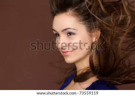 Beautiful Smiling Woman. Amazing Brunette with flying hair - stock photo
