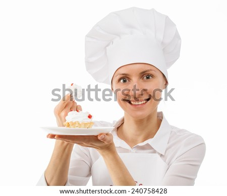 Beautiful smiling woman chef cook showing cake on a plate - stock photo
