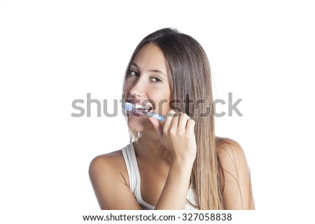 Beautiful smiling woman cleaning her teeth with a toothbrush in a dental hygiene concept. Isolated on white - stock photo