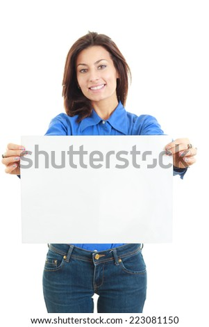 Beautiful smiling woman holding blank white board showing space for message - stock photo