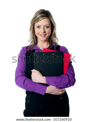Beautiful smiling woman holding documents. Looking at camera and smiling