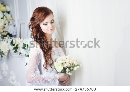 beautiful smiling woman in a wedding dress. Place for text - stock photo