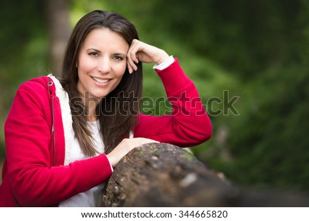 Beautiful smiling woman in bush - stock photo