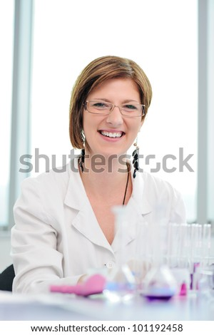 Beautiful smiling woman in laboratory - stock photo