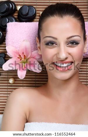 Beautiful smiling woman in spa salon - stock photo