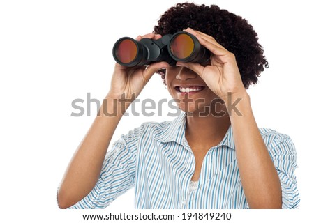 Beautiful smiling woman looking through binocular