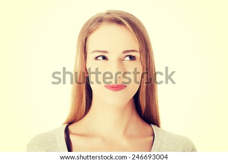 Beautiful smiling woman looking up.  - stock photo
