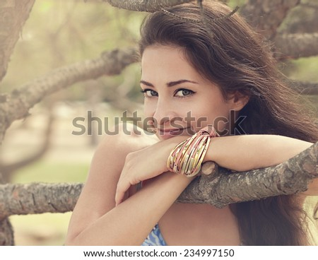 Beautiful smiling woman on nature summer background. Soft light portrait. Closeup - stock photo