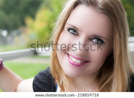 Beautiful smiling woman outdoor