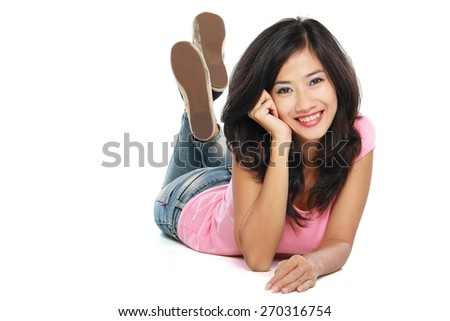 Beautiful smiling woman relaxing on the floor looking camera