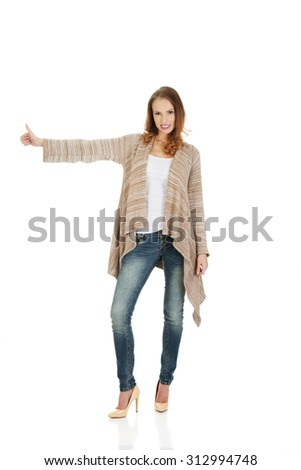 Beautiful smiling woman showing thumbs up. - stock photo