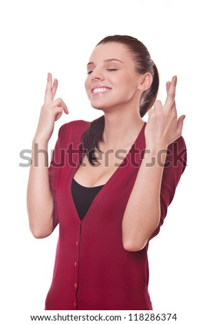 beautiful smiling woman shows crossed fingers making wish - stock photo