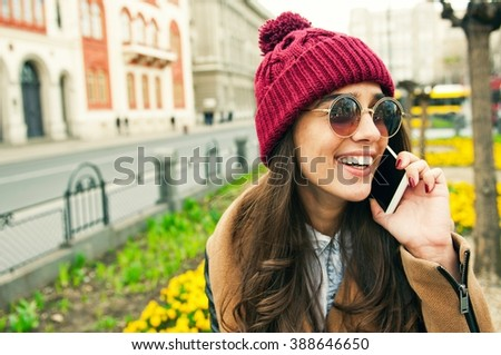 Beautiful smiling woman talking on phone - stock photo