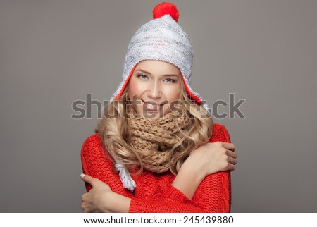 Beautiful smiling woman wearing winter clothing. - stock photo