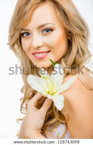 Beautiful smiling woman with a lily