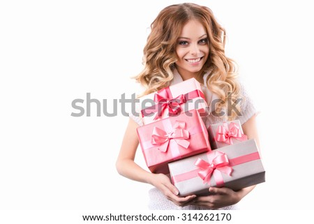 Beautiful smiling woman with curly hair holding gifts Isolated on white background. - stock photo