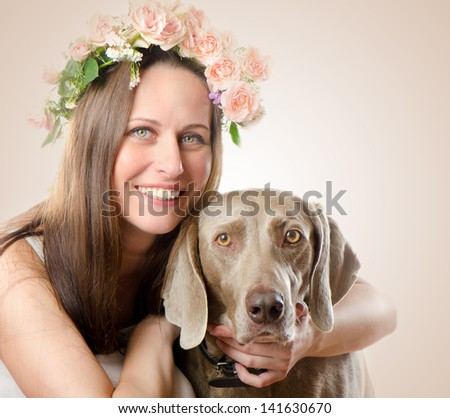 Beautiful smiling woman with dog.Vintage styled  portrait