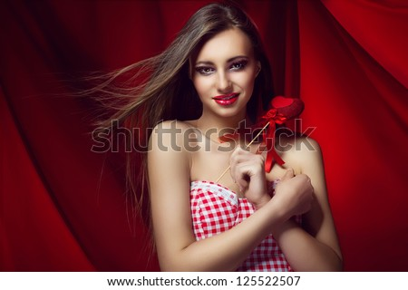 Beautiful smiling woman with heart in his hands