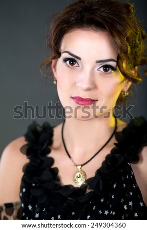 Beautiful smiling woman with natural make up, stylish hair curly dress, black blouse, expensive jewelry necklace, sexy necked shoulders, lace sequins, sad eyes full of love and hope. Vintage art style - stock photo