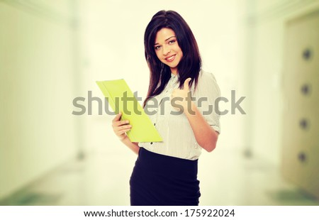 Beautiful smiling woman with thumb up. - stock photo