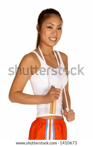 Beautiful Smiling Young Asian Woman with Jump Rope - stock photo
