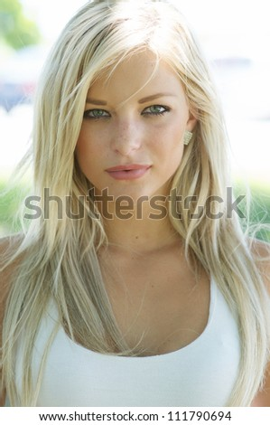 Beautiful Smiling Young Blond Woman - stock photo