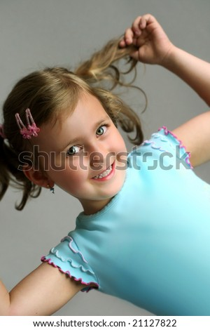 Beautiful smiling young girl with plaits