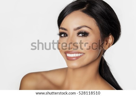 Beautiful smiling young woman, close up of face.