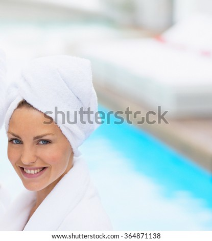 beautiful smiling young woman with a towel in spa