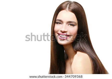 Beautiful smiling young woman with healthy shiny straight hair. Beauty shot. Isolated over white background. Copy space. - stock photo