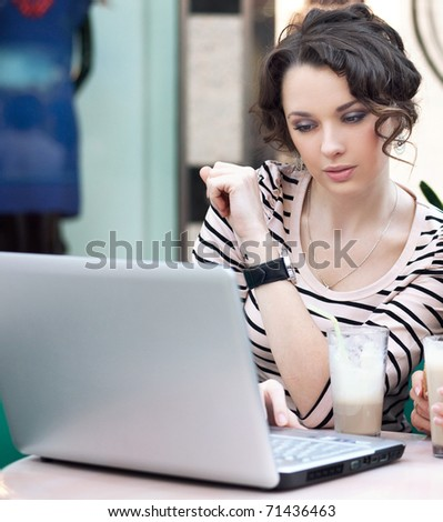 Beautiful smiling young woman with laptop