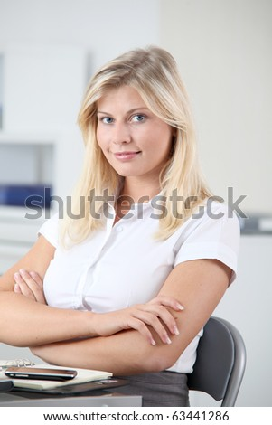 Beautiful smiling young woman working in the office