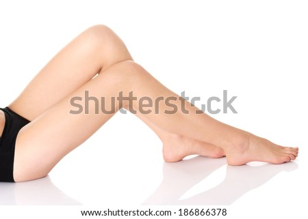 Beautiful smooth and shaved legs. Isolated on white. - stock photo