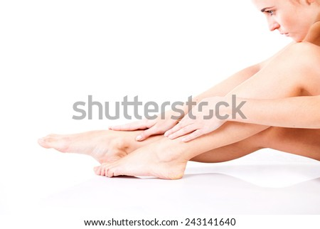 Beautiful smooth and slim female legs after depilation - stock photo