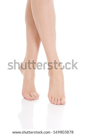 Beautiful smooth, shaved legs and feet. Isolated on white. - stock photo