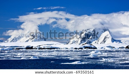 Beautiful snow-capped mountains against the blue sky in Antarctica