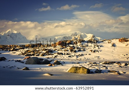 Beautiful snow-capped mountains against the sky - stock photo