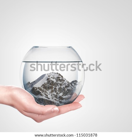 Beautiful snow-capped mountains inside a glass bowl - stock photo