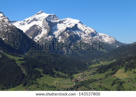 Beautiful snow capped Oldenhorn, high mountain in the Bernese Oberland - stock photo