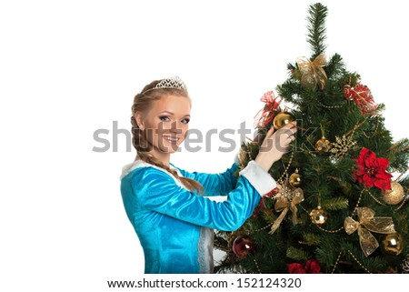Beautiful Snow Maiden decorating Christmas tree - stock photo