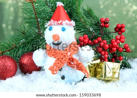 Beautiful snowman and Christmas decor, on bright background