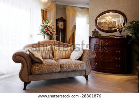 Beautiful sofa at a window in a modern apartment - stock photo