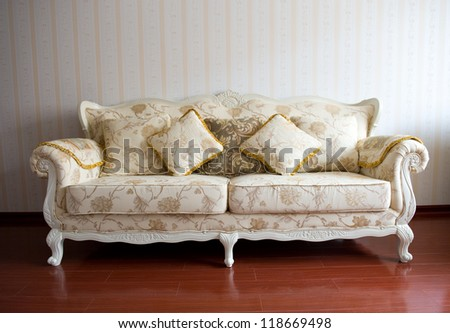 Beautiful sofa on a background of a wall - stock photo